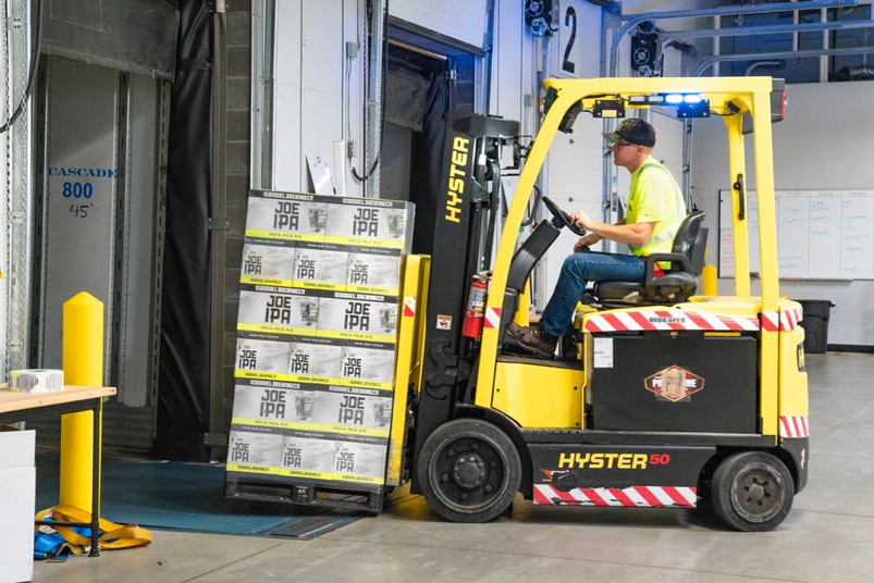 worker-using-forklift.png