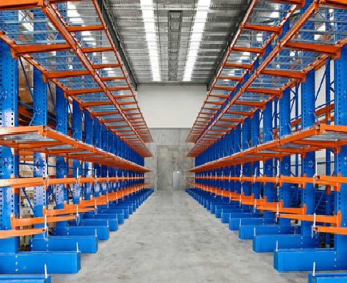 Rows of orange and blue warehouse shelving